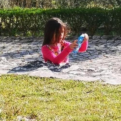 Optical Illusion Of Girl Submerged In Footpath Will Leave You BAFFLED!
